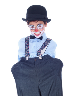happy child clown with his hands in the pockets