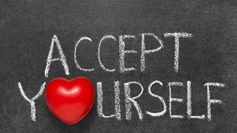 accept yourself phrase handwritten on blackboard with heart symbol instead O